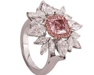 A PINK AND WHITE DIAMOND RING An elegant, classic ring, features at center a 1.28 CT fancy purple pink diamond, SI1 clarity, surrounded by an additional 3.50 ct of marquise and pear shape white diamonds, all set in platinum. With GIA certificate for central stone. Natural untreated diamonds, the white diamonds near colorless white, slightly included. GIA CERTIFICATE #2125501184
