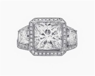 A 5.92 CT TW WHITE DIAMOND RING A very special 3.45 carat I, VVS-1 princess cut diamond ring, with two trapezoids of 2.47 carats flanking the central stone, and diamonds about the sides and inset upon the platinum band. With GIA certificate. Other diamonds are natural and untreated, near colorless white, slightly included. GIA CERTIFICATE #12782565