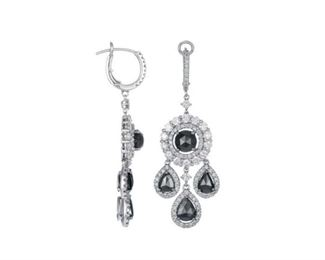A PAIR OF DIAMOND EARRINGS, 7.2 CARATS White and black diamond four-part drop earrings, a total of 7.2 carats of diamonds set in 18K white gold. Natural untreated diamonds, the white diamonds near colorless white, slightly included.