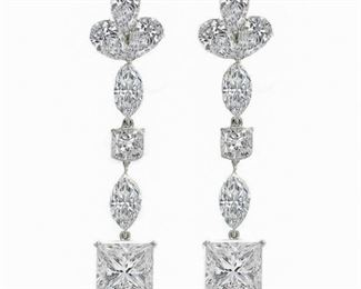 A PAIR OF LARGE, WHITE DIAMOND EARRINGS, 24.32 CARATS TW Bold and impressive 24.32 carat total weight white diamond earrings, featuring two large GIA-certified princess cut diamonds, 6.74 carats, H, SI1 and 7.06 carats, H, SI1; set with two cushion cut, 1.05 carat G, VS2 and 1.02 carat G, SI1 diamonds. Lovely! GIA CERTIFICATE #15720310 : #15720311