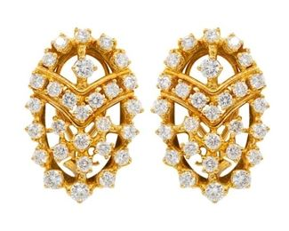 A PAIR OF DIAMOND EARRINGS, 5.0 CARATS Unique oval 18K yellow gold diamond earrings featuring 5.00 carats of round, white prong-mounted diamonds. Natural untreated diamonds, the white diamonds near colorless white, slightly included.