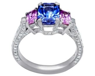 A TWO-COLOR SAPPHIRE AND DIAMOND RING Attractive three-stone ring features a 1.84 carat blue cushion-cut sapphire at center, flanked on either side by pink sapphires, 0.72 carats total, along with 1.00 carats of diamonds ornamenting the band. Natural untreated diamonds, the white diamonds near colorless white, slightly included.