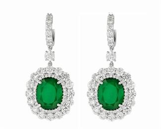 A PAIR OF EMERALD AND DIAMOND EARRINGS Bright green emerald earrings, feature 9.21 carats of GIA-certified emeralds further enhanced by the addition of 6.00 carats of round, white diamonds set all about each emerald and all in 18K white gold. Beautiful. Two GIA emerald certificates. White diamonds are natural untreated diamonds, near colorless white, slightly included. GIA CERTIFICATE #5161198268 : #2165198251