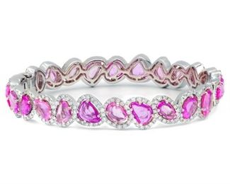A SAPPHIRE AND DIAMOND BRACELET Sapphire and diamond bracelet presenting 13.16 karats of pear-shaped pink sapphires, each surrounded by white diamonds totaling 3.00 carats, all mounted in 18K white gold. Natural untreated diamonds, the white diamonds near colorless white, slightly included.