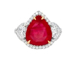A RUBY AND DIAMOND RING A magnificent ruby and diamond ring, the 6.27 carat ruby GIA certified and set with 1.70 carats or round diamonds in a platinum halo, with the special addition of two heart-shaped diamonds, both GIA certified, set on either side of the central stone. With GIA ruby certificate and two GIA diamond certificates. Other diamonds are natural untreated diamonds, near colorless white, slightly included. THREE GIA CERTIFICATES #2183395231 : #5171381272 : #52165325639