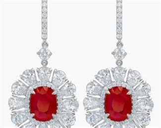 RUBY AND DIAMOND EARRINGS Beautiful ruby and diamond earrings, feature GIA certified 3.42 and 3.27 carat oval-shaped rubies in a diamond halo setting and the entirely surrounded by a total of 8.30 carats of pear-shaped white diamonds, set in 18K white gold. With two GIA ruby certificates. Natural untreated diamonds, near colorless white, slightly included. GIA CERTIFICATE #2181396952 : #6187396508