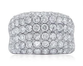 A DIAMOND FASHION RING Wonderful diamond-laden fashion ring, seven rows of diamonds totaling 3.20 carats, all set in 18K white gold. Natural untreated diamonds, near colorless white, slightly included.