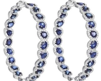 A PAIR OF SAPPHIRE AND DIAMOND EARRINGS Sapphire and diamond hoop earrings, 16.25 total carats of pear-shaped blue sapphires, each surrounded by white diamonds with a total of 3.13 carats of diamonds, all set in 18K white gold. Natural untreated diamonds, near colorless white, slightly included.
