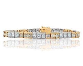A YELLOW AND WHITE DIAMOND TENNIS BRACELET Impressive two-tone diamond tennis bracelet, features 42 yellow and white diamonds cleverly set in matching 18K yellow and gold channel settings. Natural untreated diamonds, the white diamonds near colorless white, slightly included.