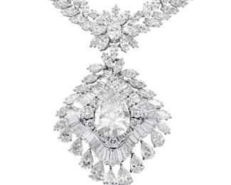 AN IMPRESSIVE WHITE DIAMOND NECKLACE***** A spectacular diamond necklace featuring an impressive 9.01 carat pear-shaped diamond, GIA certified K, VS2. This gem is surrounded by dozens of diamonds in a variety of shapes, with a similar cluster with a smaller central diamond just above. The necklace on this art piece is further enhanced with by two rows of marquise cut diamonds, all set in 18K white gold. Excepting the separately-graded central diamond, all other stones are natural untreated diamonds, near colorless white. A total of approx. 60 carats of white diamonds make this an exceptional piece, perfect for the most important functions. GIA CERTIFICATE #1152571178