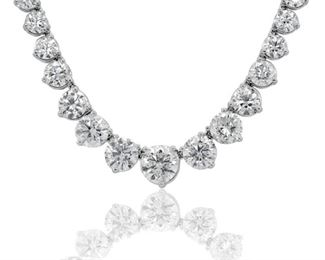 A DIAMOND TENNIS NECKLACE, 24.80 CARATS Graduated diamond tennis necklace, 89 round diamonds of increasing sizes totaling 24.80 carats, in three prong settings, 18KT white gold settings. Natural untreated diamonds, near colorless white, slightly included.