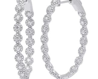 A PAIR OF DIAMOND EARRINGS Understated diamond oval hoop earrings, 2.05 carats of white round set in 14K white gold. Natural untreated diamonds, the white diamonds near colorless white, slightly included.