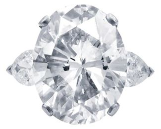 A LARGE DIAMOND RING, 17.13 CARATS Breathtaking 17.13 carat oval diamond, EGL certified (OVC246) JSI2 EGL J, SI-2, set in platinum with two side-mounted white pear-shaped diamonds totaling .80 carats. Stunning. With EGL certificate. Side stones are near colorless white, slightly included. EGL CERTIFICATE #US 314537601D