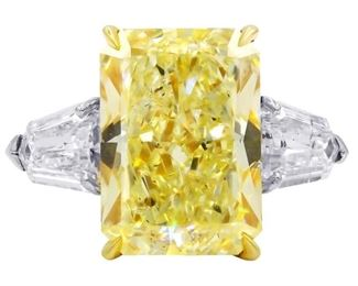 A YELLOW AND WHITE DIAMOND RING Superb yellow and white diamond ring, features a cushion cut 10.15 carat fancy yellow diamond, SI2 (RADC1053) at center, enhanced with the addition of 1.80 carats total of bullet cut white diamonds on the sides, all set in platinum. With GIA certificate for central stone. The white diamonds are natural, near colorless white, slightly included. GIA CERTIFICATE #17480434