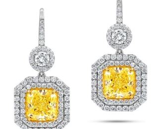 A PAIR OF YELLOW AND WHITE DIAMOND EARRINGS Attractive yellow diamond earring set, features two cushion cut fancy light yellow diamonds, both GIA certified 2.61 carats VS1 (RAD1038) and 3.02 carats VS2 (RADC1040), presented in double halo settings with a total of 1.75 carats of white diamonds, F-G, VS. With two GIA certificates. Natural untreated diamonds, the white diamonds near colorless white, slightly included. GIA CERTIFICATE #1176907289 : #2175907283