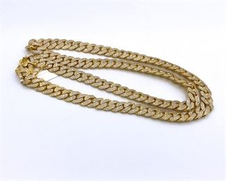 A DIAMOND AND GOLD NECKLACE Diamond encrusted 14KT yellow gold Cuban link necklace, over 16.00 karats of diamonds embedded in the links. Natural untreated diamonds, the white diamonds near colorless white, slightly included (G/H, SI). Natural untreated diamonds, the white diamonds near colorless white, slightly included.