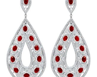 A PAIR OF RUBY AND DIAMOND EARRINGS Ruby and diamond earrings, 22.91 carats of rubies with 15.03 carats of white diamonds, a beautiful assemblage arranged on setting of 18K white gold. Natural untreated diamonds, the white diamonds near colorless white, slightly included.