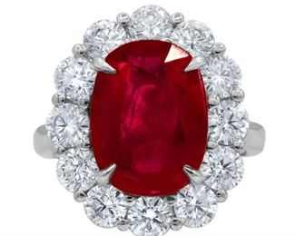 A RUBY AND DIAMOND RING A classic beauty, a 6.06 carat ruby, GIA certified, surrounded by 2.50 carats of 12 round cut diamonds, all set in platinum. With C. Dunaigre Laboratory gemstone report. Natural untreated diamonds, near colorless white, slightly included. C. DUNAIGRE CERTIFICATE #CDC 1801873