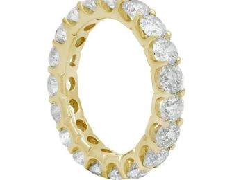 A DIAMOND ETERNITY BAND Diamond Eternity band, 18 karat yellow gold Eternity band features round cut diamonds,weighing 3.00 cts total. Natural untreated diamonds, the white diamonds near colorless white, slightly included unless specified otherwise.