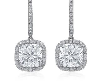A PAIR OF DIAMOND EARRINGS, 5.22 CARATS TW Elegant cushion cut diamond drop earrings features two GIA certified 3.02 carat GIA certified diamonds, J in color, SI2 in clarity, surrounded by delicate micro pave halo diamonds which themselves total 2.20 carats. With two GIA certificates. Other diamonds are natural and untreated, near colorless white, slightly included unless specified otherwise. GIA CERTIFICATE #6202628852 : #7201628848