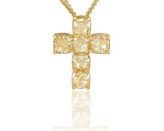 A YELLOW AND WHITE DIAMOND CROSS, 6.10 CARATS A rare natural yellow diamond cross, 6.10 carats of yellow diamonds, each stone over one carat, all set in 18K yellow gold. Natural untreated diamonds.