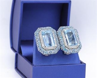 A PAIR OF AQUAMARINE AND DIAMOND EARRINGS Distinctive aquamarine and diamond earrings, 25.00 carats (total) of lustrous blue aquamarines mounted in the center and surrounded by double rows of aquamarines and and 2.00 carats of round, white diamonds. Settings are 14K white gold. Natural untreated diamonds, the white diamonds near colorless white, slightly included unless specified otherwise.