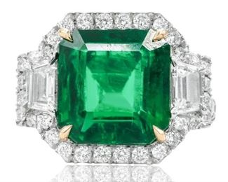 AN EMERALD AND DIAMOND RING Fabulous green emerald ring, a 6.67 carat emerald set in place by four yellow 18k gold prongs, set amidst 1.40 carats of white diamonds in a halo setting, the entirety set in on platinum ring. With C. Dunaigre Laboratory emerald certificate. The diamonds are near colorless white, slightly included unless specified otherwise. C. DUNAIGRE CERTIFICATE #CDC 1908730