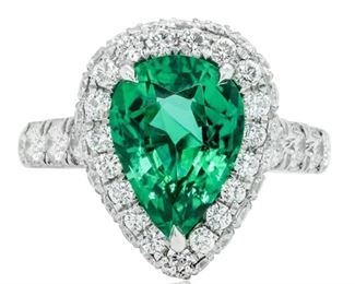 AN EMERALD AND DIAMOND RING Classic green emerald and diamond ring. the center stone a 3.59 natural green pear-shaped emerald set with 2.00 carats of diamonds graded F-G, VS-SI in a pave custom-made setting. The brilliant diamonds extend half the way down the shank of the platinum setting. With C. Dunaigre Laboratory emerald certificate. Natural untreated diamonds, the white diamonds near colorless white, slightly included. C. DUNAIGRE CERTIFICATE #CDC 1908729