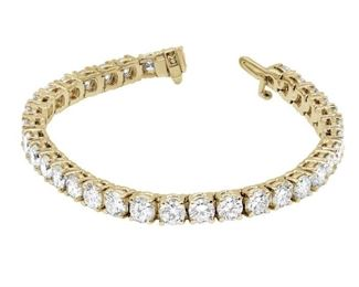 A DIAMOND TENNIS BRACELET, 4.59 CARATS 14 karat yellow gold diamond tennis bracelet with 54 round brilliant cut diamonds weighing 4.59 carats total. Natural untreated diamonds, near colorless white, slightly included.