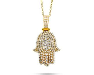 A DIAMOND AND GOLD HAMSA PENDANT Hamsa pendant, 14K yellow gold graced with 2.50 carats of white diamonds. The Hamsa Hand is an ancient Middle Eastern amulet symbolizing the Hand of God. In all faiths it is a protective sign, bringing its owner happiness, luck, health, and good fortune.