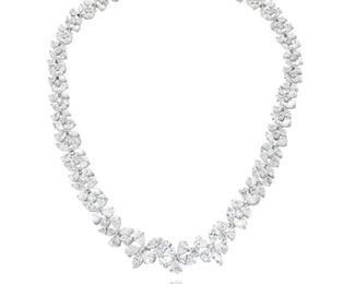 A DIAMOND NECKLACE, 53.10 CARATS An innovative, very impressive diamond-heavy platinum necklace graced with 53.10 total carats of differently faceted white diamonds, including 23.66 carats of pear-shaped diamonds, 21.42 carats of marquise-cut diamonds, and 8.02 carats of round diamonds. Natural untreated diamonds, the white diamonds near colorless white.