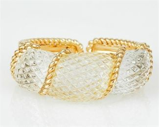 """A SABBADINI CUFF BRACELET Gorgeous piece of Italian jewelry by Sabbadini Milano, a cuff crafted in 18K gold and featuring carved rock crystal. The cuff's inner circumference is 5 1/2 inches, width 7/8 inch. The piece is signed Sabbadini, stamped with origin, """"750"""" purity mark, and Sabbadini maker's mark."""
