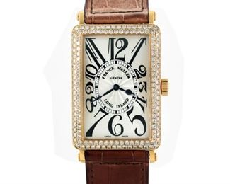 FRANCK MULLER LONG ISLAND Franck Muller Long Island yellow gold 30 x 44mm. case watch with a double row of diamonds framing the case, gold bezel and clasp, screw-down crown, automatic movement, crocodile strap. Very good condition showing little or no wear. With original box.