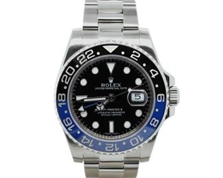 ROLEX GMT MASTER II Rolex Oyster Perpetual GMT Master II, stainless steel 40mm. case with steel Oyster bracelet, black and blue bezel and black dial, automatic movement. Very goo, exhibiting little to no signs of wear. Original Rolex box.