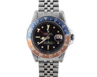 """PEPSI ROLEX GMT-MASTER Ultra-desirable vintage """"Pepsi"""" Rolex GMT-Master, stainless steel 40mm. case and bracelet, black dial, date, and trademark blue and red bezel, plexi-crystal. Very good condition, the bezel slightly lightened. 1959, With original box and papers."""