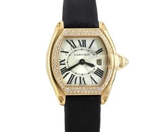 CARTIER ROADSTER Elegant ladies' Cartier Roadster, yellow gold case with rows of diamonds on the case surrounding the dial, leather strap. 2009. Very good, little to no wear.