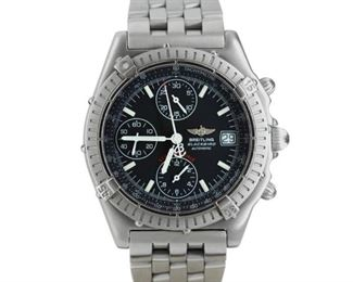 BREITLING BLACKBIRD Breitling Blackbird, 39mm. stainless steel case and band, black dial with luminescent indices and displaying date, movable bezel with luminescent dot, chronograph and tachometer, small seconds, screw-down crown. Fine condition.