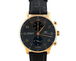 """IWC PORTUGUESE CHRONOGRAPH IWC Portuguese Chronograph, rose gold 41mm. case and bezel, automatic chronograph movement, gray-black dial, brown alligator band approx. 7.5"""" long. Serial number: 50xxxxxx. Near new condition, with original box and papers."""