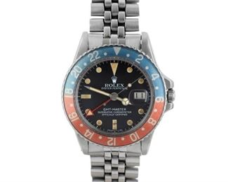 """PEPSI ROLEX GMT-MASTER Ultra-desirable vintage """"Pepsi"""" Rolex GMT-Master, stainless steel 40mm. case and bracelet, black dial, date, and trademark blue and read bezel, plexi-crystal. Good condition, the bezel slightly lightened, luminescent indices need repainting. 1978."""