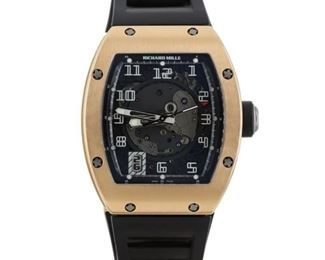 RICHARD MILLE RM 005 Most desirable Richard Mille RM 005, rose gold case with rubber band with double-fold rose gold clasp, automatic movement with date, 2008. In near-new condition, with original box and papers.