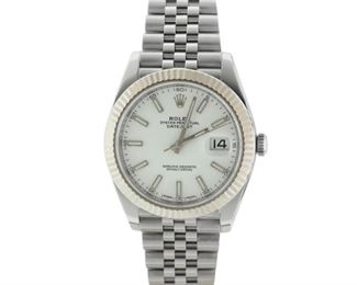ROLEX DATEJUST Rolex Datejust, 41mm. stainless steel case with matching stainless band, in mint condition, no sign of wear. With Rolex warranty card.