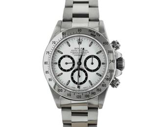 ROLEX OYSTER PERPETUAL DAYTONA Rolex Daytona, stainless steel 40mm. case and bracelet, white dial, automatic chronograph. 1993. With original Rolex box.