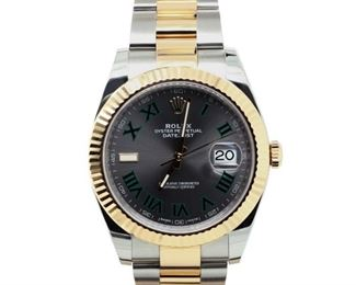 ROLEX DATEJUST WITH BLACK DIAL Distinctive Rolex Datejust, 41mm. steel case with gold fluted bezel, gold and steel bracelet. A very distinctive dial features black on gray Roman numerals, with luminescent hands and indices. 2018. Very good, little or no signs of use.