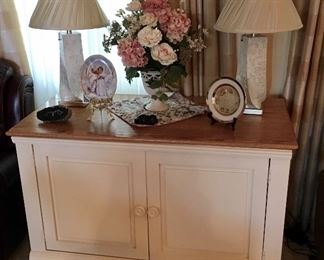 Excellent White Wood Cabinet with Wood tone top.
