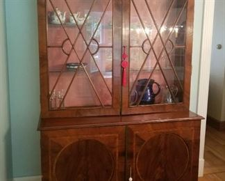 Fantastic Inlaid China Cabinet with distinctive glass doors and molding,