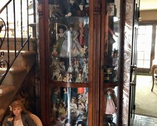 Glass front antique cabinet, Dolls