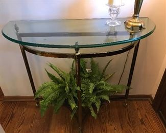 Gold demilune accent table; faux fern