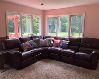 Lazy Boy 3pc. leather sectional.  Set from the highest  grain of leather when purchased. Color can best be described as a brownish burgundy.