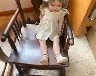 Shirley Temple doll an antique chair/high chair