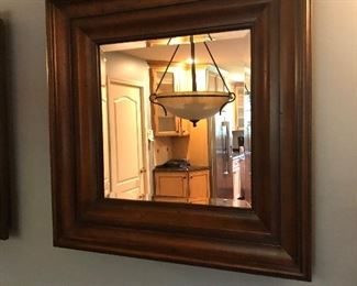 One of a pair of beveled glass mirrors